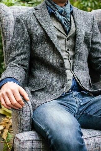 How to wear: grey herringbone wool blazer, grey herringbone wool waistcoat, blue denim shirt, blue jeans