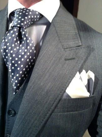 How to wear: charcoal blazer, navy waistcoat, white dress shirt, navy polka dot silk tie