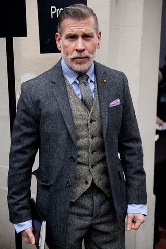 How to wear: charcoal wool blazer, grey herringbone waistcoat, light blue dress shirt, grey herringbone dress pants