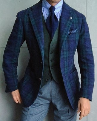 How to wear: navy and green plaid blazer, olive wool waistcoat, light blue vertical striped dress shirt, grey wool dress pants