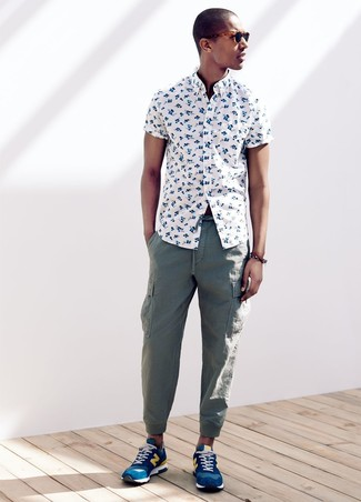 How to wear: blue athletic shoes, green cargo pants, white floral short sleeve shirt