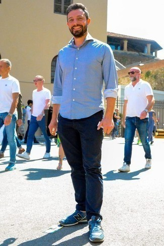 How to Wear a Light Blue Chambray Long Sleeve Shirt For Men: This is undeniable proof that a light blue chambray long sleeve shirt and navy chinos look amazing when paired together in a laid-back ensemble. Finishing off with a pair of blue athletic shoes is a fail-safe way to add an easy-going touch to your look.