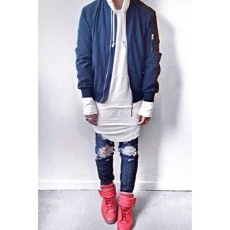 How to wear: blue bomber jacket, white hoodie, navy ripped jeans, red leather high top sneakers