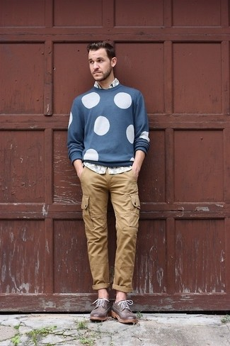 How to wear: blue polka dot crew-neck sweater, grey print long sleeve shirt, khaki cargo pants, dark brown leather brogues