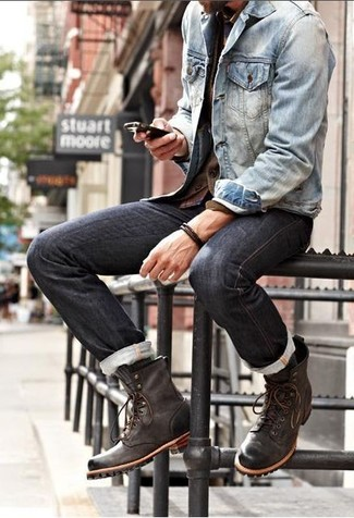 Consider wearing a blue denim jacket and black jeans for an easy to wear, everyday look. Mix things up by wearing dark brown leather casual boots.
