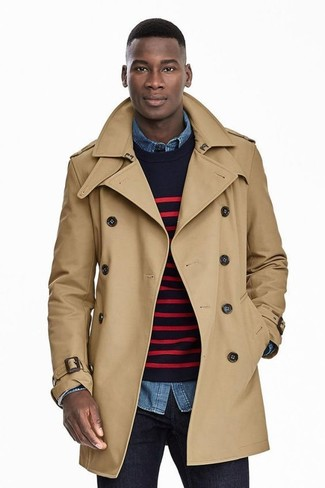 How to wear: navy jeans, blue denim shirt, navy and red horizontal striped crew-neck sweater, tan trenchcoat
