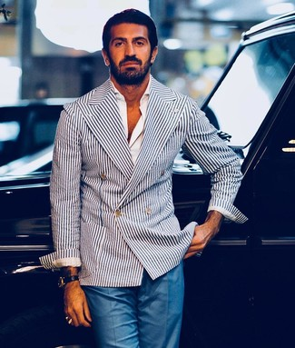 How to wear: black leather watch, blue dress pants, white long sleeve shirt, white and navy vertical striped double breasted blazer