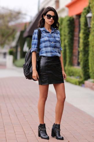 How to wear: blue plaid dress shirt, black leather mini skirt, black leather ankle boots, black leather backpack