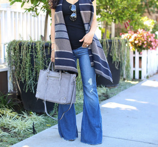 How to wear: grey leather tote bag, blue flare jeans, black tank, navy horizontal striped wool vest