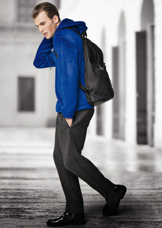 How to wear: blue hoodie, charcoal sweatpants, black leather casual boots, black backpack