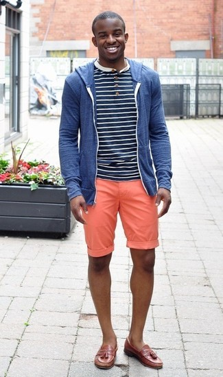 How to wear: blue hoodie, navy and white horizontal striped henley shirt, orange shorts, brown leather tassel loafers