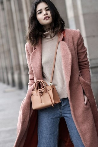 How to wear: tan leather crossbody bag, blue jeans, beige turtleneck, pink coat