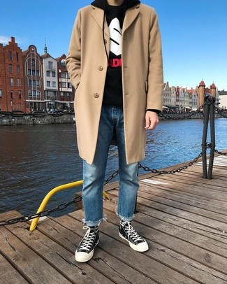 How to wear: black and white canvas high top sneakers, blue jeans, black print hoodie, beige overcoat