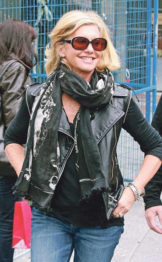 How to wear: black print scarf, blue jeans, black tank, black leather biker jacket
