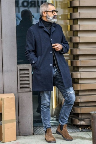 How to wear: brown suede chelsea boots, blue ripped jeans, black turtleneck, black overcoat