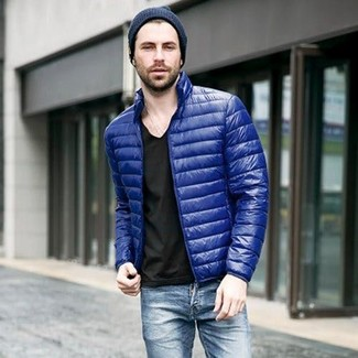 How to wear: navy beanie, blue jeans, black v-neck t-shirt, blue puffer jacket