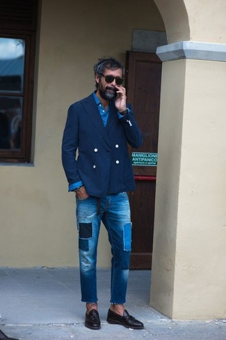 How to wear: black leather tassel loafers, blue patchwork jeans, blue long sleeve shirt, navy double breasted blazer