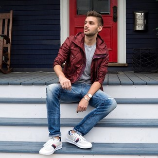 How to wear: white leather low top sneakers, blue jeans, grey crew-neck t-shirt, burgundy windbreaker