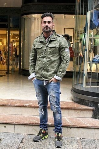 How to Wear Blue Ripped Jeans For Men: An olive camouflage military jacket and blue ripped jeans are a good look to add to your day-to-day casual repertoire. A pair of charcoal athletic shoes easily kicks up the appeal of your outfit.