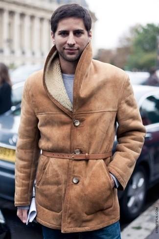 How to wear: tan leather belt, blue jeans, grey sweatshirt, tan shearling coat