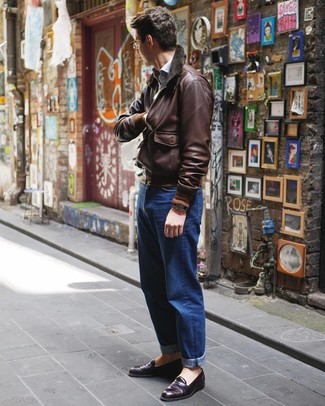 How to wear: dark purple leather loafers, blue jeans, light blue long sleeve shirt, dark brown leather bomber jacket