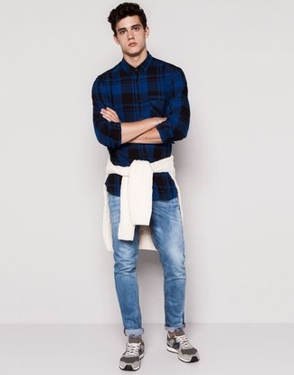 How to wear: grey suede low top sneakers, blue jeans, navy plaid long sleeve shirt, white cable sweater