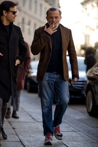 How to Wear a Navy Turtleneck For Men: This casual pairing of a navy turtleneck and blue jeans is very easy to put together without a second thought, helping you look dapper and prepared for anything without spending too much time digging through your wardrobe. Clueless about how to round off? Introduce a pair of grey suede athletic shoes to your outfit to spice things up.