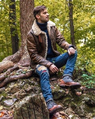 How to wear: brown leather casual boots, blue ripped jeans, navy wool turtleneck, brown shearling jacket