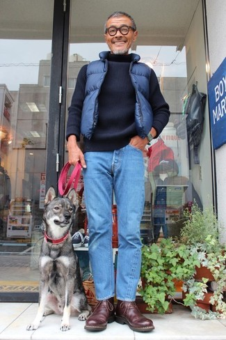 How to wear: dark brown leather desert boots, blue jeans, navy knit turtleneck, navy quilted gilet