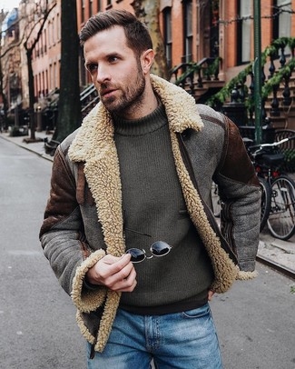 How to wear: blue jeans, olive crew-neck sweater, dark brown shearling jacket