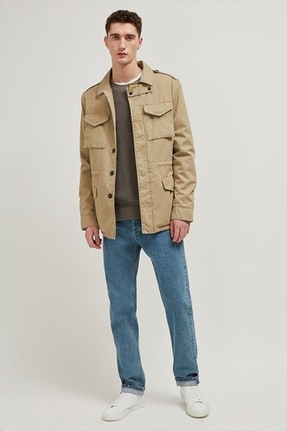 How to wear: white leather low top sneakers, blue jeans, olive crew-neck sweater, khaki field jacket