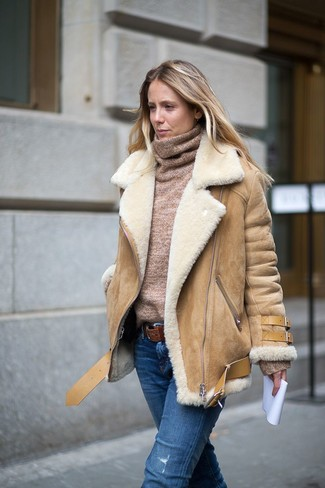 How to wear: brown leather belt, blue ripped jeans, tan turtleneck, tan shearling jacket