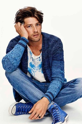 How to wear: blue high top sneakers, blue jeans, white and blue print crew-neck t-shirt, blue knit cardigan