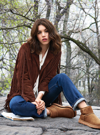 How to wear: brown uggs, blue jeans, white button down blouse, dark brown fringe suede open jacket