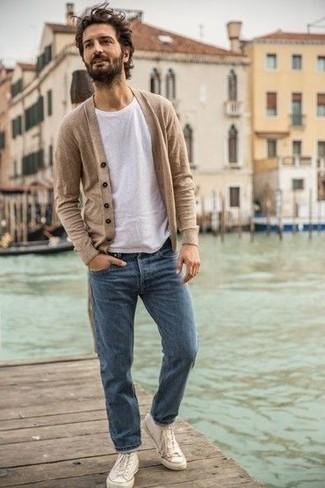 Men's Looks & Outfits: What To Wear In 2020: If you feel more confident wearing something functional, you'll love this seriously stylish combo of a beige cardigan and blue jeans. White canvas high top sneakers will give a fun feel to an otherwise mostly classic look.