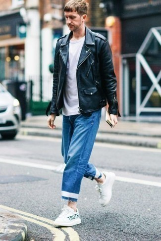 How to Wear White Print Leather Low Top Sneakers For Men: Fashionable and comfortable, this off-duty combo of a black leather biker jacket and blue jeans provides variety. The whole getup comes together when you add a pair of white print leather low top sneakers to your getup.