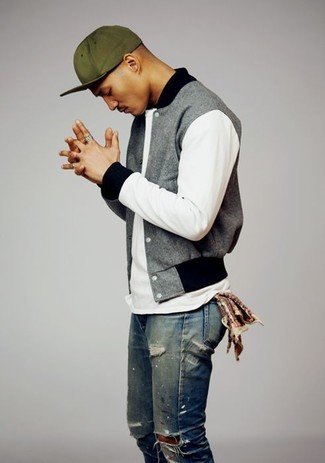 How to wear: olive baseball cap, blue ripped jeans, white crew-neck t-shirt, grey varsity jacket