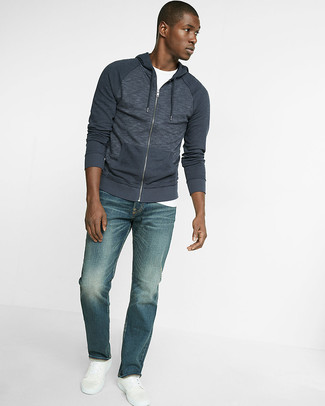 How to wear: white leather low top sneakers, blue jeans, white crew-neck t-shirt, navy hoodie