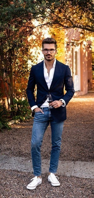 How to Wear Blue Jeans For Men: The formula for casually sophisticated menswear style? A navy blazer with blue jeans. For something more on the daring side to finish off this look, complement this outfit with a pair of white canvas low top sneakers.
