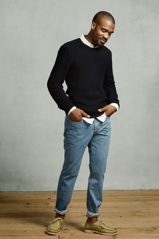 How to wear: olive leather boat shoes, blue jeans, white long sleeve shirt, black crew-neck sweater