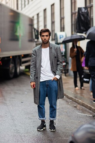 How to Wear Blue Jeans For Men: If the setting calls for a casually neat outfit, you can opt for a grey herringbone overcoat and blue jeans. For something more on the cool and laid-back side to finish off this ensemble, introduce a pair of black athletic shoes to your outfit.