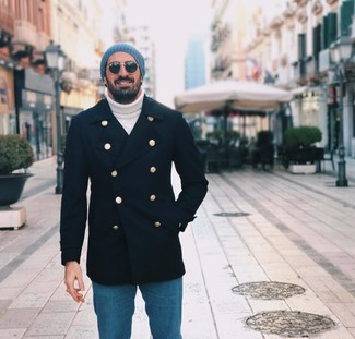 How to wear: blue beanie, blue jeans, white knit turtleneck, navy pea coat