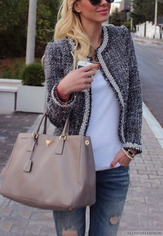 How to wear: grey leather tote bag, blue ripped jeans, white v-neck t-shirt, navy tweed jacket