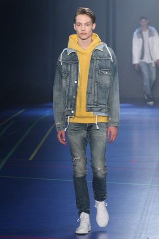 How to wear: white leather high top sneakers, blue ripped jeans, yellow hoodie, blue denim jacket