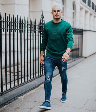 How to wear: silver watch, blue suede low top sneakers, navy ripped skinny jeans, dark green sweatshirt