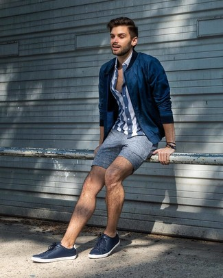 How to wear: navy leather low top sneakers, blue linen shorts, navy and white vertical striped short sleeve shirt, navy bomber jacket