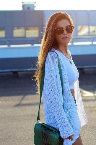 How to wear: green leather crossbody bag, blue denim shorts, white cropped top, white knit open cardigan