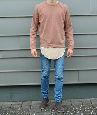 How to Wear Dark Brown Suede Chelsea Boots For Men: If it's comfort and functionality that you're searching for in an outfit, wear a pink sweatshirt and blue skinny jeans. Unimpressed with this look? Introduce a pair of dark brown suede chelsea boots to jazz things up.
