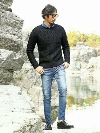 Men's Looks & Outfits: What To Wear In 2020: Extremely dapper and practical, this relaxed combination of a black cable sweater and blue skinny jeans will provide you with amazing styling possibilities. Introduce black leather derby shoes to the equation to completely jazz up the getup.