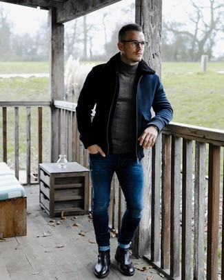 How to wear: black leather chelsea boots, blue skinny jeans, charcoal turtleneck, navy wool bomber jacket